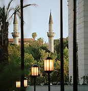Minarets of the Tekkiye Mosque, contrasted with new urban development in Damascus, Syria