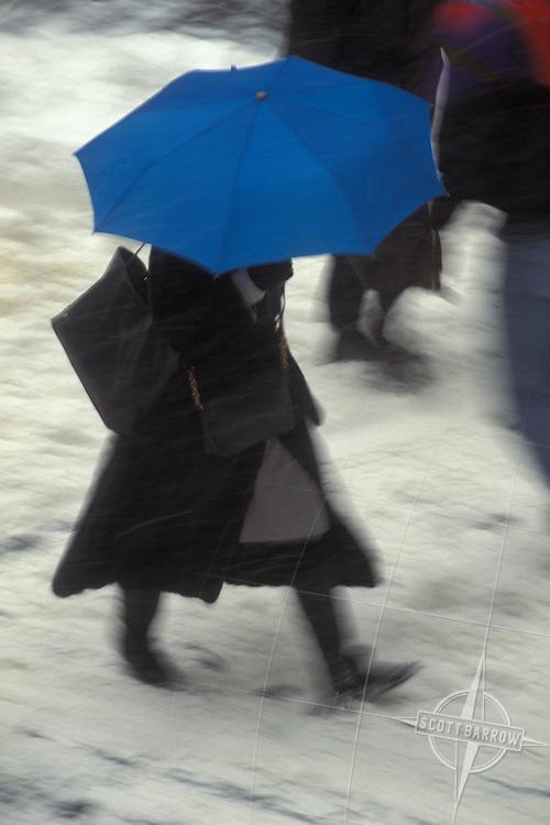Pedestrian with umbrella in snowy New York City