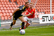 Wimbledon midfielder Scott Wagstaff (7) in action  during the EFL Sky Bet League 1 match between Blackpool and AFC Wimbledon at Bloomfield Road, Blackpool, England on 20 October 2018.