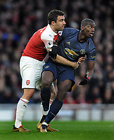 Football - 2018 / 2019 Premier League - Arsenal vs. Manchester United<br /> <br /> Sokratis of Arsenal grabs hold of Paul Pogba of United, at The Emirates.<br /> <br /> COLORSPORT/ANDREW COWIE