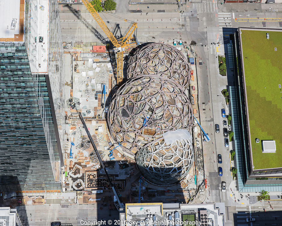 The Spheres under construction at the Amazon headquarters campus in Seattle's Denny Triangle neighborhood. The three glass domes share the block bounded by 6th and 7th Avenues, from Lenora Street to Blanchard, and shares the block with Amazon Tower II, formally named Day 1.