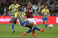 Janoi Donacien of Accrington Stanley tackles Sofiane Feghouli of West Ham United. EFL Cup, 3rd round match, West Ham Utd v Accrington Stanley at the London Stadium, Queen Elizabeth Olympic Park in London on Wednesday 21st September 2016.<br /> pic by John Patrick Fletcher, Andrew Orchard sports photography.