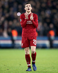 Liverpool's Andrew Robertson applauds the fans at the end of the match