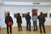spectators at a photo Exhibition, A matter of Faith by Danny Yanai, Israel, February 2007