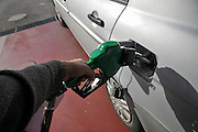 Petrol Station car is refuelled with unleaded petrol