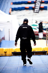 Francesco Bruni makes his way down the dock. Korea Match Cup 2010. World match Racing Tour. Gyeonggi, Korea. 12 June 2010. Photo: Gareth Cooke/Subzero Images