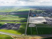 Nederland, Noord-Holland, Gemeente Purmerend, 16-04-2012; zicht op polder De Purmer langs de as van de Middentocht, poldergemaal in de voorgrond. Rechts opgespoten zand voor uitbreiding van het bedrijventerrein  De Baanstee..View on polder the Purmer and the city of Purmerend. Regular land division. .luchtfoto (toeslag), aerial photo (additional fee required);.copyright foto/photo Siebe Swart