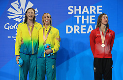 Australia's Bronte Campbell celebrates winning Gold with Australia's Cate Campbell who won Silver in the Women's 100m Freestyle Final alongside Canada's Taylor Ruck who won Bronze at the Gold Coast Aquatic Centre during day five of the 2018 Commonwealth Games in the Gold Coast, Australia.