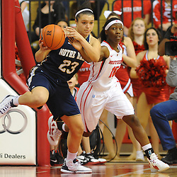 Notre Dame Fighting Irish guard Kayla McBride (23) is fouled by Rutgers Scarlet Knights guard Syessence Davis (15) during first half NCAA Big East women's basketball action between Notre Dame and Rutgers at the Louis Brown Athletic Center. Notre Dame leads 40-23 at halftime.