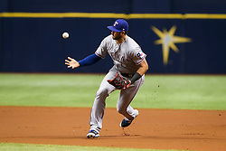 July 21, 2017 - St. Petersburg, Florida, U.S. - WILL VRAGOVIC       Times.Texas Rangers third baseman Joey Gallo (13) mishandles the ground ball by Tampa Bay Rays center fielder Mallex Smith (0) who reaches on the error in the first inning of the game between the Texas Rangers and the Tampa Bay Rays at Tropicana Field in St. Petersburg, Fla. on Friday, July 21, 2017. (Credit Image: © Will Vragovic/Tampa Bay Times via ZUMA Wire)