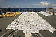 Navy seizes a TONNE of heroin worth £160million hidden inside sacks of cement on a tiny sailing boat in the Indian Ocean<br /> <br /> A tonne of heroin worth almost £160million has been found hidden inside sacks of cement on a tiny sailing boat in the Indian Ocean.<br /> <br /> The crew of an Australian warship intercepted the dhow 27 nautical miles east of the Kenyan port city of Mombasa and discovered the drugs stowed in 46 separate bags.<br /> <br /> The seizure is largest ever in the history of the Combined Maritime Forces, a joint operation between 30 countries to combat piracy, militancy and smuggling in the waters east of Africa.<br /> <br /> The frigate HMAS Darwin intercepted the vessel on Wednesday night and confiscated 1,023 kg  of heroin, according to Australia's Defence Department.<br /> <br /> The drugs were destroyed, the online statement said.<br /> <br /> 'This is a major heroin seizure, which has removed a major source of funding from terrorist criminal networks,' said the ship's commanding officer Commander Terry Morrison.<br /> <br /> The coup came as part of the joint operation's bid to preserve order in a huge region spanning the Red Sea, Gulf of Aden, Arabian Gulf, Arabian Sea, Indian Ocean and the Gulf of Oman.<br /> <br /> The area includes the waters off Somalia's Horn of Africa, which have been blighted by piracy including several high-profile hijackings of British yachts.<br /> <br /> Kenyan defence spokesman Bogita Ongeri told Nigeria's Saturday Nation that the haul was not seized within Kenya's territorial waters.<br /> <br /> 'I can authoritatively say that the seizure of such heroin never happened within our Exclusive Economic Zone,' he said.<br /> <br /> 'We are doing daily surveillance within our territorial waters and we have not received such a report.'<br /> <br /> News agencies described the vessel as a dhow, a traditional African and Middle Eastern sailing boat, although no sails were erected when it was photographed by the Aus
