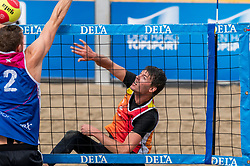 Jeffrey van Wijk in action. The DELA NK Beach volleyball for men and women will be played in The Hague Beach Stadium on the beach of Scheveningen on 22 July 2020 in Zaandam.