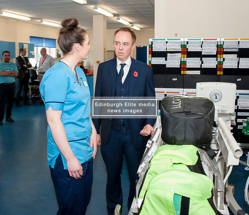 Europe Minister Alasdair Allan MSP toured the Royal Infirmary of Edinburgh to announce the evidence submitted by the Scottish Government on the benefits of EU migrants to the Scottish economy.<br /> <br /> Pictured: Europe Minister Alasdair Allan meets Ciara Hutchison from Ireland, a radiographer working in the Medical Physics Department. <br /> <br /> © Dave Johnston/ EEm