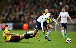 Watford's Craig Cathcart (left) and Tottenham Hotspur's Dele Alli battle for the ball during the Premier League match at Wembley Stadium. London.