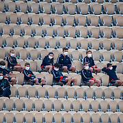 PARIS, FRANCE September 27.  Ball boys and ball girls high in the stands watching Simona Halep of Romania in action against Sara Sorribes Tormo of Spain on Court Philippe-Chatrier in the first round of the singles competition during day one of the French Open Tennis Tournament at Roland Garros on September 27th 2020 in Paris, France. (Photo by Tim Clayton/Corbis via Getty Images)