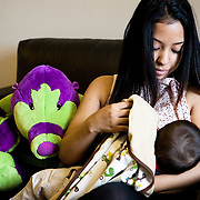 London, UK, December 15th, 2011..Teenage Parents Service at the Stockwell YMCA charity in Lambeth, South London..Melissa, 18 years old, from Colombia, with her son Jayson, 6 months old. She got pregnant when she was 17.