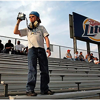 Race fan Ryan Steenstra(cq), 13,(of Eastover, NC) shoots some video from the stands as things get underway at the IHRA Spring Nationals at the Rockingham Dragway  Friday, April 22, 2005. Rain set in around 7:30.