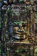 """The Bayon, Angkor Thom, Siem Reap, Cambodia<br /> <br /> Built around 1190 AD by King Jayavarman VII, the Bayon is a Buddhist temple incorporating elements of Hindu cosmology. The Bayon Temple is believed to represent the intersection of heaven and earth, at the exact centre of Angkor Thom.<br /> <br /> It is known for its huge stone faces of the bodhisattva Avalokiteshvara, with one facing outward and keeping watch at each compass point. The curious smiling image, thought by many to be a portrait of Jayavarman VII himself, has been dubbed by some the """"Mona Lisa of Southeast Asia."""" There are 51 smaller towers surrounding the Bayon, each with four faces of its own."""