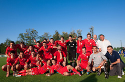 Players of Aluminij celebrate with a Champions Trophy after the football match between NK Aluminij Kidricevo and NK Roltek Dob in 27th, last Round of 2nd SNL, on May 19, 2012 in Sports park Kidricevo, Slovenia. NK Aluminij defeated NK Dob 2-1, won 2nd SNL and qualified to 1st SNL. (Photo by Vid Ponikvar / Sportida.com)
