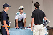 An incoming Citadel freshman known as a knob lines up watched by upperclassmen during matriculation day on August 17, 2013 in Charleston, South Carolina. The Citadel is a state military college that began in 1843.
