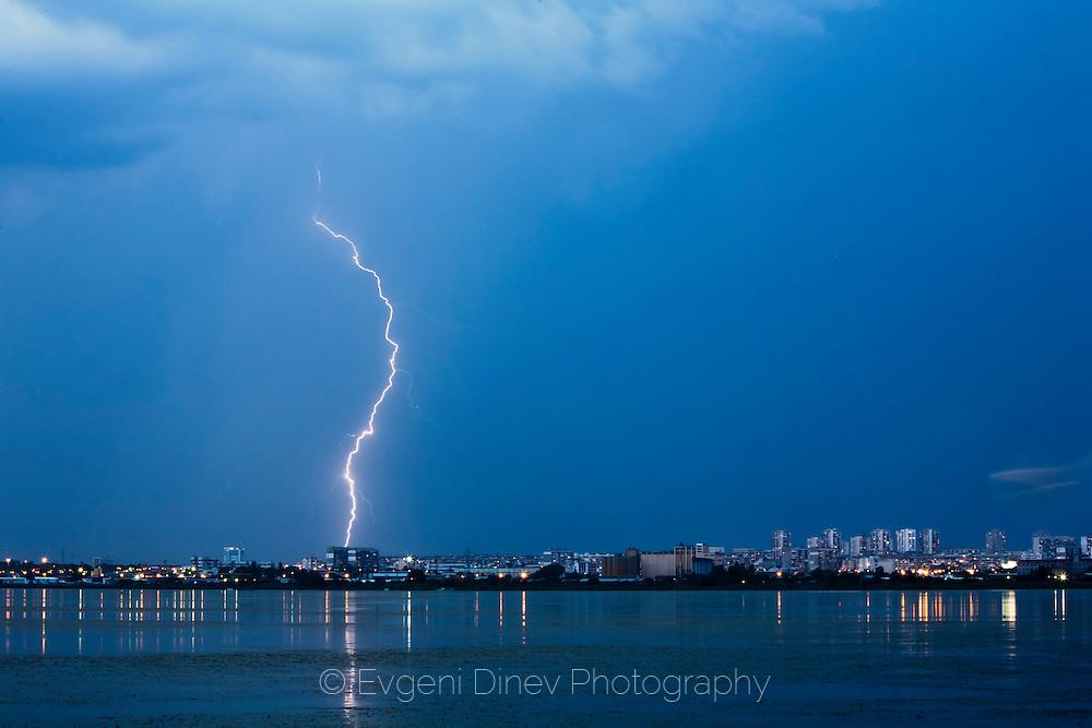 Lightnings in the lake at dusk