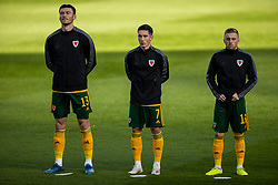 DUBLIN, REPUBLIC OF IRELAND - Sunday, October 11, 2020: Wales' Kieffer Moore, Harry Wilson and Joseff Morrell line-up for the national anthem before the UEFA Nations League Group Stage League B Group 4 match between Republic of Ireland and Wales at the Aviva Stadium. The game ended in a 0-0 draw. (Pic by David Rawcliffe/Propaganda)