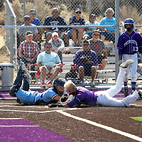 Goddard Rocket catcher Cinco Holloway, left, tries to tag Miyamura Patriot Joel Lopez out at home Tuesday morning in Gallup. Lopez slid into home plate safe scoring a run for the Patriots.