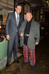 Left to right, MATTHIAS ROEKE managing director of Rosewood London and STEVEN BERKOFF at the Installation And Reveal Of Gerald Scarfe's Exclusive Artworks In Scarfes Bar at Rosewood Hotel, 252 High Holborn, London on 7th April 2014.