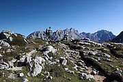 Hikers reach the cairn that marks the Collada el Jito viewpoint over the Picos de Europa, in northern Spain