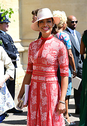 Gina Torres leaves St George's Chapel at Windsor Castle after the wedding of Meghan Markle and Prince Harry.