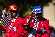 """11 NOVEMBER 2013 - PHOENIX, AZ: MICHAEL WEBB and RICHARD """"Dick"""" TOLIVER, both veterans of the Tuskegee Airmen, an all African-American fighter squadron in World War II, at the Phoenix Veterans Day Parade. The Phoenix Veterans Day Parade is one of the largest in the United States. Thousands of people line the 3.5 mile parade route and more than 85 units participate in the parade. The theme of this year's parade is """"saluting America's veterans.""""    PHOTO BY JACK KURTZ"""