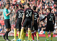 Football - 2016 / 2017 Premier League - Arsenal vs. Manchester City.<br /> <br /> In a week when Manchester City were fined for crowding the referee the once again gather after a disputed decision at The Emirates.<br /> <br /> COLORSPORT/DANIEL BEARHAM