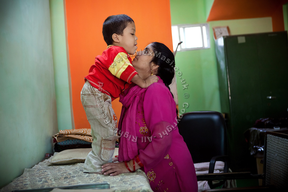 A disabled child is awaiting therapy inside Chingari Trust, the local NGO caring for disabled  children in Bhopal, Madhya Pradesh, India, near the abandoned Union Carbide (now DOW Chemical) industrial complex.
