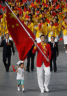 BEIJING, CHINA:  Chinese hero and NBA player Yao Ming carries the Chinese Flag inside the National Stadium during the 2008 Olympiad Opening Ceremony in Beijing, China on Friday, 8/8/08. Thousands of athletes from all over the world marched in the stadium representing their various countries.  ©2008 Johnny Crawford