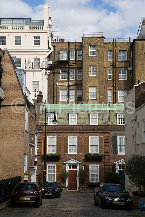Mix of architecture in Belgravia London, United Kingdom. Belgravia is a district in West London in the City of Westminster and the Royal Borough of Kensington and Chelsea. It is noted for its very expensive residential properties and is one of the wealthiest districts in the world. Much of it, known as the Grosvenor Estate, is still owned by a family property company, the Duke of Westminsters Grosvenor Group.