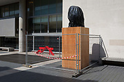The head of former South African activist and president Nelson Mandela, an artwork by sculptor Ian Walters, has been covered to protect it from right-wing protesters as a result of slavery profiteers statues being targetted by the Black Lives Matter movement. The far-right have been promising to attack prominent statues of black politicians such as Mandela here, outside the Royal festival Hall on the Southbank, and elsewhere like Parliament Square, on 23rd June 2020, in London, England.