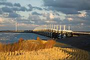 Nederland, Zeeland, Oosterschelde, 03-12-2008; Zealand, storm surge barrier in Oosterschelde (East Scheldt), between Islands of Schouwen-Duiveland and Noord-Beveland; North Sea on this side of the barrier; the sand on the beach in the forground has been suplemented (in order to protect the coast); on the new small dunes marram grass (beach-grass) has been planted; under normal circumstances the barrier is open to allow for the tide to enter / exit; in case of high tides in combination with storm, the slides are closed; Oosterscheldekering gezien van het strand van Noord-Beveland naar Schouwen-Duiveland, aan deze zijde van de kering de Noordzee; in de voorgond neiouw zand op het strand, resultaat van zandsuppletie, op de jonge duintjes is helmgras geplant; <br /> foto/photo  Siebe Swart