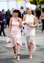 Racegoers arrive for the Grand National Day of the 2018 Randox Health Grand National Festival at Aintree Racecourse, Liverpool.
