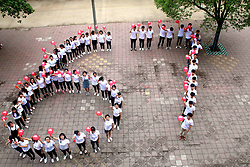 June 4, 2017 - Ji'An, Ji'an, China - Ji'an, CHINA-June 4 2017: (EDITORIAL USE ONLY. CHINA OUT) ..Senior high school students pose for a group photo at a high school in Ji'an, east China's Jiangxi Province, June 4th, 2017, showing that they are ready for the upcoming National Higher Education Entrance Examination which will be held on June 7th, 2017. (Credit Image: © SIPA Asia via ZUMA Wire)