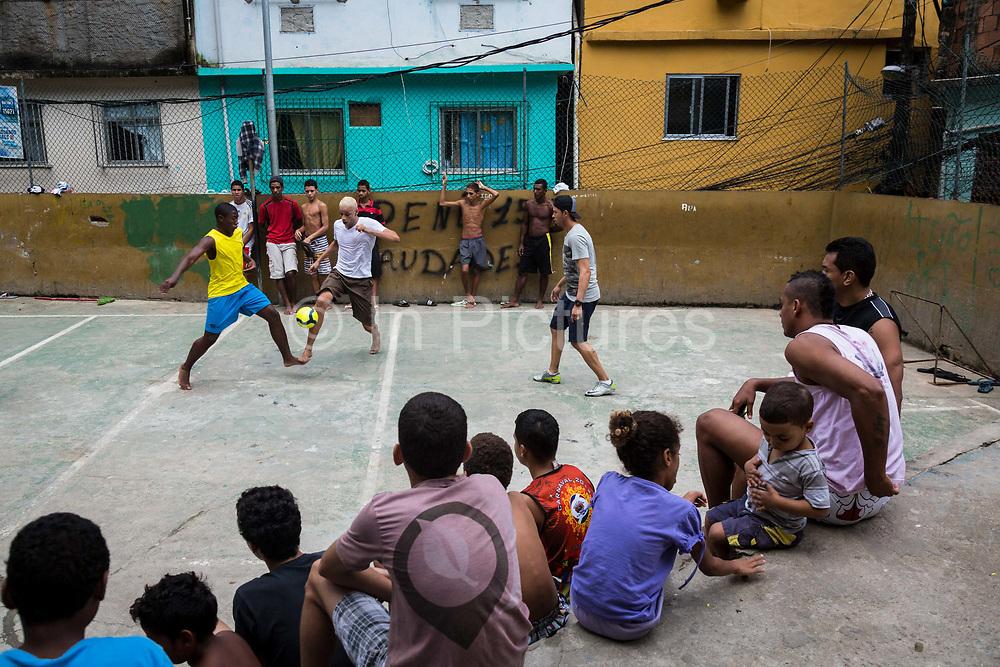 "Inside Rocinha favela boys play ""futsal"", also known as ""society"" football. Football, Samba and Carnival harness the community spirit, Rio de Janeiro."