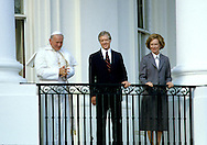 Pope John Paul II and President  Carter and First Lady Rosalynn Carter on the balcony of the White House in October 1979..Photograph by Dennis Brack bb30