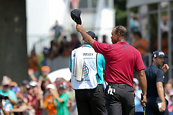 August 5, 2018 - Akron, Ohio, United States - Tiger Woods (R) and his caddie Joe LaCava waves to the crowd as he walks off the 18th green after the final round of the WGC-Bridgestone Invitational at Firestone Country Club. (Credit Image: © Debby Wong via ZUMA Wire)