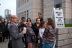August 8, 2017 - Denver, Colorado, U.S - Jeffrey P Colwell, Clerk of Court, speaks to those in line (Swift fans and other people) about how the day will go at the Taylor Swift Groping Trial against radio DJ David Mueller at the Alfred A. Arraj United States Courthouse in Denver, Colorado, U.S., on Tuesday, August 8, 2017. (Credit Image: © Matthew Staver via ZUMA Wire)