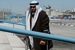 March 28, 2019 - Jerusalem, Israel - A man enters the Qalandiya Crossing for processing and entry to Jerusalem. $11 million renovations have recently been completed at the Qalandiya Crossing, the main crossing between northern Judea and Samaria and Jerusalem. Renovations were carried out in order to enhance processing of some 7,000 Palestinians every day, entering Jerusalem for work, medical care or other necessities. Upgrades include implementation of technology available at modern airports while giving consideration to security requirements. Processing of an incoming Palestinian now takes between 4-7 minutes. The Mod's Coordinator of Government Activities in the Territories (COGAT) is responsible for implementing the government's civilian policy within Judea and Samaria and for coordination and liaison with the Palestinian Authority. (Credit Image: © Nir Alon/ZUMA Wire)