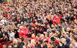 Players, staff and fans in the stands take part in a minutes applause in memory of former Manchester United youth coach Eric Harrison during the Premier League match at Old Trafford, Manchester.
