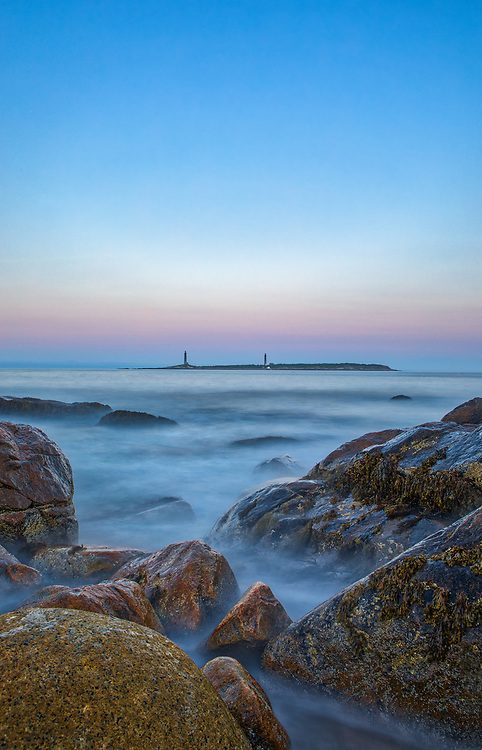 Massachusetts seascape photography of the Thacher Island Twin Lights at dusk. The South Tower and North Tower lighthouses are located on Cape Ann, Massachusetts.<br /> <br /> Picturesque New England lighthouse photography images are available as museum quality photography prints, canvas prints, acrylic prints, wood prints or metal prints. Fine art prints may be framed and matted to the individual liking and interior design decorating needs:<br /> <br /> https://juergen-roth.pixels.com/featured/thacher-island-twin-lights-juergen-roth.html<br /> <br /> Good light and happy photo making!<br /> <br /> My best,<br /> <br /> Juergen