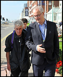 Publisher Iain Dale makes up with  protester Stuart Holmes after their incident on the seafront this morning before The Labour leader Ed Miliband   Keynote speech to the Labour Party Conference delegates at the Brighton Conference Centre, Brighton, United Kingdom. Tuesday, 24th September 2013. Picture by Andrew Parsons / i-Images