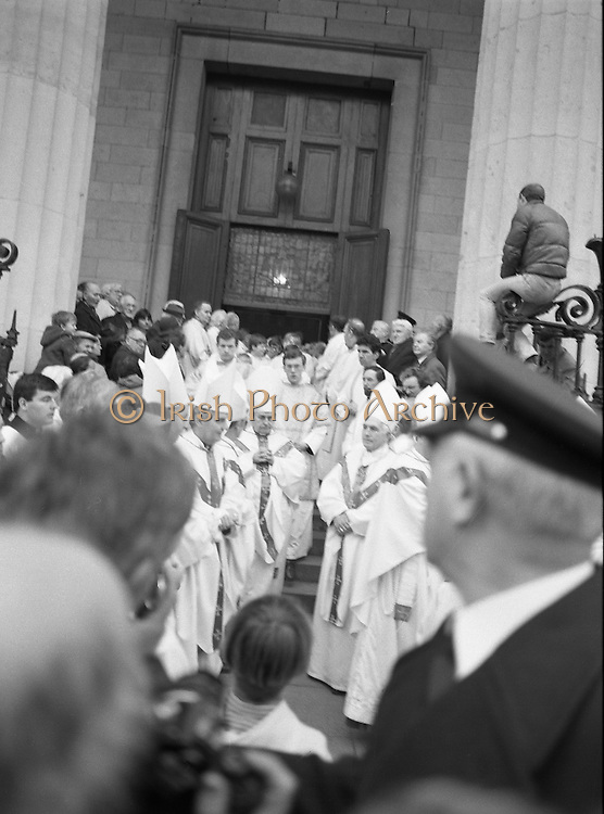 Funeral Of Sean McBride.   (R71)..1988..18.01.1988..01.18.1988..18th January 1988..Today saw the Funeral of Seán McBride.Seán MacBride was an Irish government minister, a prominent international politician and a former Chief of Staff of the IRA. His funeral took place from the Pro-Cathedral in Dublin to the family plot in Glasnevin Cemetery, Dublin.The Chief mourners were Tiernan McBride,son, Anna White,daughter and Declan White, son in law...The Irish heirarchy led by Cardinal Tomás O'Fiach leave the Pro-Cathedral after the funeral mass for Seán McBride.