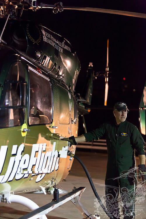 Pat DeVore, LifeFlight pilot, fills up the tank before taking off.