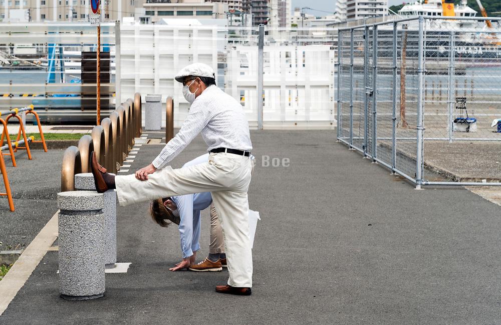 senior couple doing streching exercise Japan Yokosuka